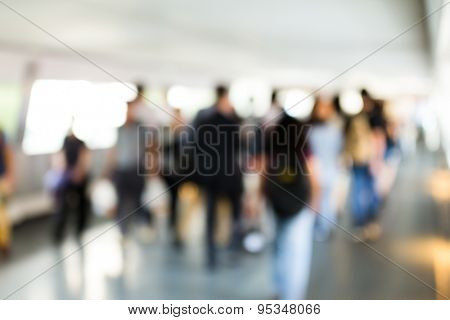 Blur bokeh of footbridge with crowded pedestrian