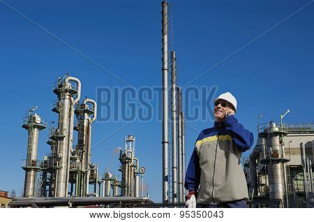 refinery worker with chemical industry in background