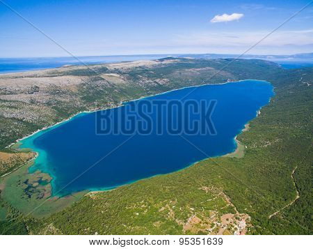 Lake Vrana on Cres Island shot from drone at 700m in altitude. A fresh water lake which is below sea level.
