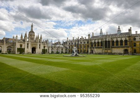 CAMBRIDGE, ENGLAND - MAY 13: Wide View of Courtyard with Manicured Green Lawn with Kings College Gatehouse on Left, University of Cambridge, England on May 13, 2015