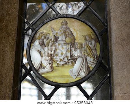 CAMBRIDGE, ENGLAND - MAY 13: Close Up of Religious Themed Artwork Embedded in Window - Architectural Detail of Spiritual Worship Circular Artwork at Kings College, Cambridge, England on May 13, 2015