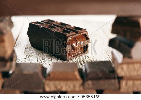 Stuffed chocolate trough frame of chocolate, closeup