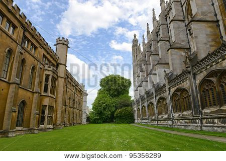 CAMBRIDGE, ENGLAND - MAY 13: Manicured Green Lawn and Trees Between Historical Buildings on Kings College Campus, University of Cambridge, England on May 13, 2015