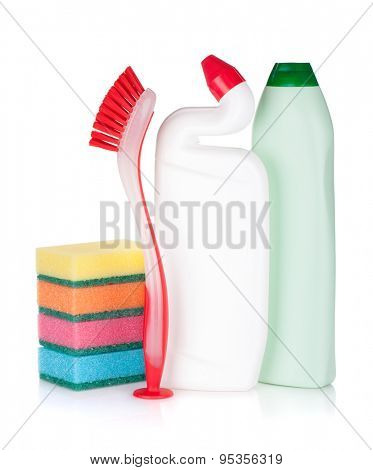 Plastic bottles of cleaning products, sponges and brush. Isolated on white background