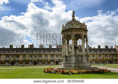 CAMBRIDGE, ENGLAND - MAY 13: Historical stone fountain at Trinity College, Cambridge University, cambridge standing in the middle of neatly manicured green lawns in the Great Court on May 13, 2015