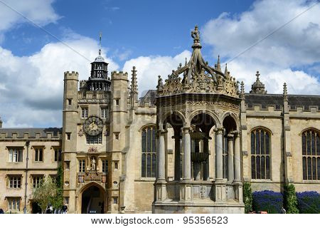 CAMBRIDGE, ENGLAND - MAY 13: Historical architecture of Trinity College,Cambridge University, Cambridge, UK, with the Kings Gate, chapel and detail of the fountain in the foreground on May 13, 2015