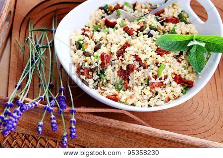 bowl of bulgur salad  with dry tomato - food and drink