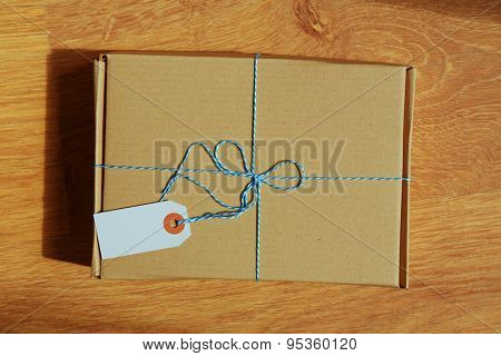 Mail package parcel on wooden table, top view