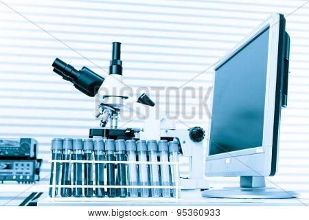 laboratory bench with microscope