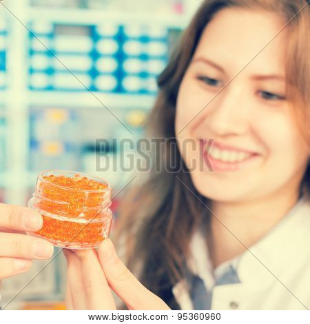 Technician In the laboratory testing food quality artificial fish caviar