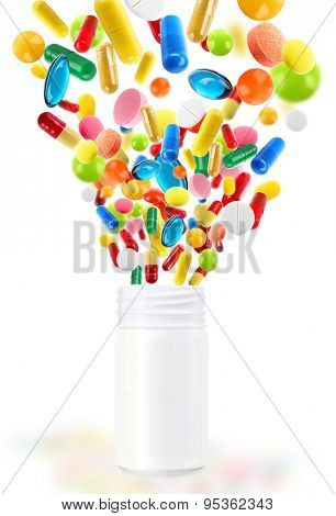 Different pills flying away from open plastic bottle isolated on white