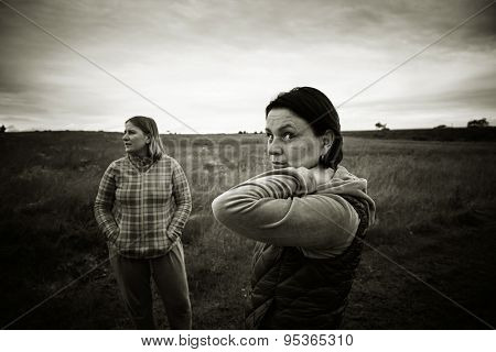 Two mature womens in a meadow. Black and white photo