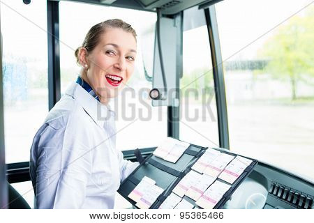 Bus driver woman selling tickets from drivers seat