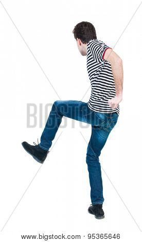 back view skinny guy funny fights waving his arms and legs. Isolated over white background.Rear view people collection. backside view of person. Funny guy clumsily boxing. guy in striped shirt jumping