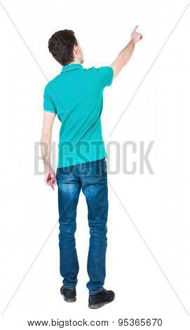 Back view of  pointing young men in  shirt and jeans. Young guy  gesture. Rear view people collection.   Isolated over white background. guy in a stylish T-shirt shows a finger of his right hand up