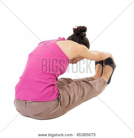 Back view of the girl sitting in front of a warm up exercise.  Rear view people collection.  backside view of person.  Isolated over white background. African-American woman stretching warming up feet