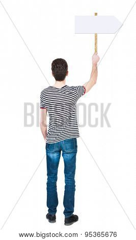 Back view man showing sign board. man holds information plate. Rear view people collection. backside view of person. Isolated over white background. guy in the striped shirt points to right pointer