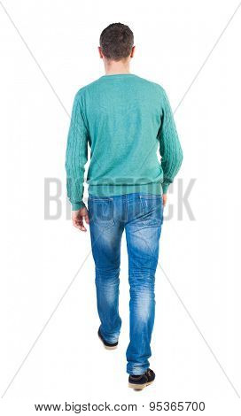 Back view of going  handsome man in jeans and a shirt.  walking young guy . Rear view people collection.  backside view person. Isolated over white background. The guy in green jacket comes back to us
