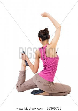 Back view of girl sitting in front  warm up exercise. Rear view people collection.  backside view person. Isolated over white background. African-American woman in yoga pose leg presses to body