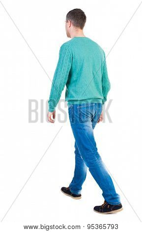 Back view going  handsome man in jeans a shirt. walking young guy . Rear view people collection.  backside view of person.  Isolated over white background. guy in the green jacket slowly pass us by.