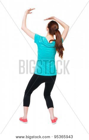 back view woman protects hands from what is falling from above. woMan holding a heavy load  backside view person.  Isolated over white background.  Sports girl hiding from what is falling from above