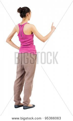 back view of woman. Young woman presses down on something. Isolated over white background.  African-American woman standing sideways with his hand in his pocket a second hand presses.