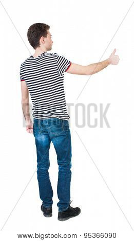 Back view of  man in shirt shows thumbs up.   Rear view people collection.  backside view person.  Isolated over white background.  The guy in the striped T-shirt shows the right hand thumb up. right.
