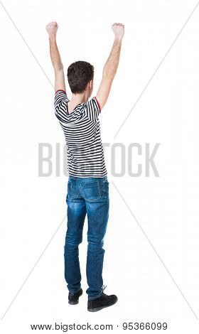 Back view of  man.  Raised his fist up in victory sign.   Rear view people collection.  backside view person.  Isolated over white background. The guy in the striped violently happy raising fists up.