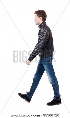 Back view of going  handsome man in jacket.  walking young guy . Rear view people collection.  backside view of person.  Isolated over white background. A guy in a jacket sadly left out.