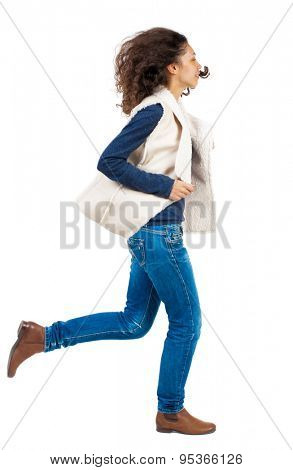 back view of running  woman. beautiful girl in motion. backside view of person.  Rear view people collection. Isolated over white background. Girl in sheep rushes right with fluttering hair.