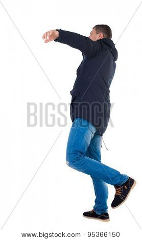 Balancing young man in parka.  or dodge the falling man. Rear view people collection.  backside view of person.  Isolated over white background. The falling man.