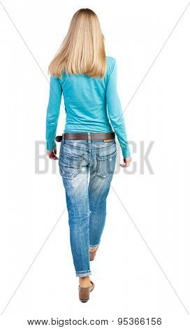 back view of walking  woman. beautiful girl in motion.  backside view of person.  Rear view people collection. Isolated over white background. The girl in a blue sweater goes deep into the frame.