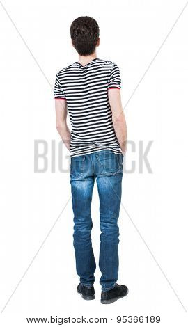 Back view of man in jeans. Standing young guy. Rear view people collection.  backside view of person.  Isolated over white background. A guy in a T-shirt is his hands in the front pockets of his jeans
