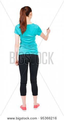 back view of writing beautiful woman. Young girl in sweatpants. Rear view people collection.  backside view of person. Isolated over white background. Sports girl draws something marker.