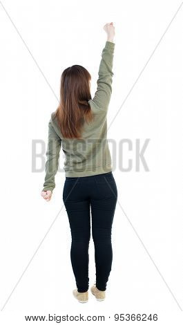 back view of dancing young beautiful  woman. girl  watching. Rear view people collection.  backside view of person. Isolated over white background. A woman in a gray sweater in pose of Superman flying