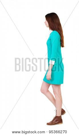 back view of walking  woman. beautiful girl in motion.  backside view of person.  Rear view people collection. Isolated over white background. girl in a stylish vintage dress goes left.
