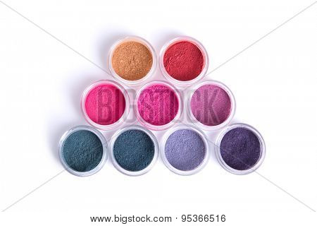 Set of colorful vegan eye shadows, top view isolated on white background