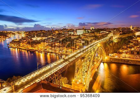 Porto, Portugal Skyline over Dom Luis I Bridge and Douro River.