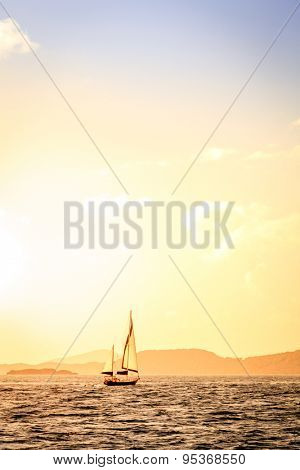 Sailboat under sails at sunset in British Virgin Islands