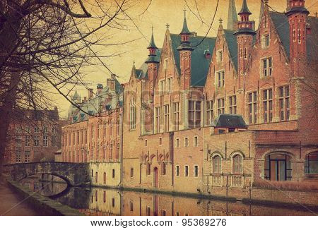 A canal in Bruges, Belgium. Photo in retro style.  Added paper texture.