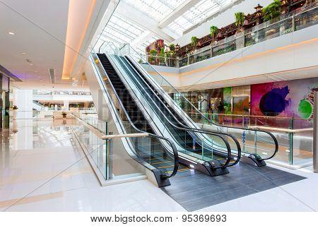 Escalator in modern shopping mall