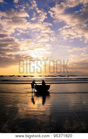 Fishers work on the beach in sunrise in My Khe beach, Da nang, Vietnam