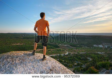 Man on peak of mountain. Element of design.