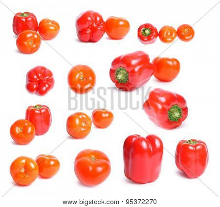 ripe tomatoes and peppers set on white