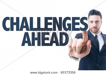 Business man pointing the text: Challenges Ahead