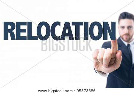 Business man pointing the text: Relocation