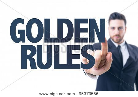 Business man pointing the text: Golden Rules