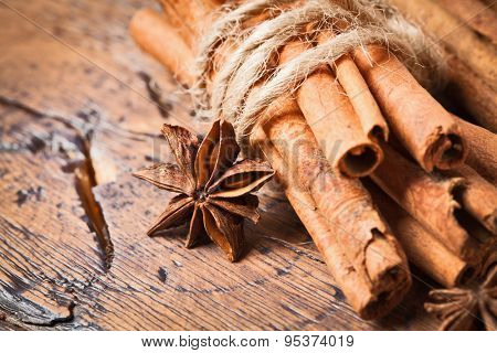 Clove and cinnamon closeup on wood background. Christmas spices