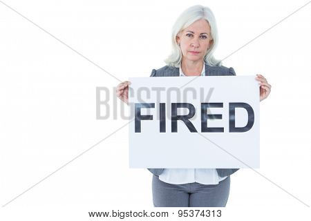 Businesswoman holding sign in front of her on white background