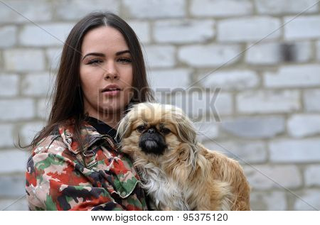 Teen girl with small dog